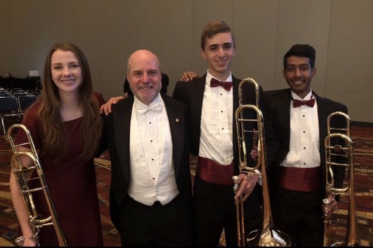 Frybergh (second from right) is seen with previous band director Alexander Kaminsky and two of his fellow trombone players. Photo courtesy of Hunter Frybergh