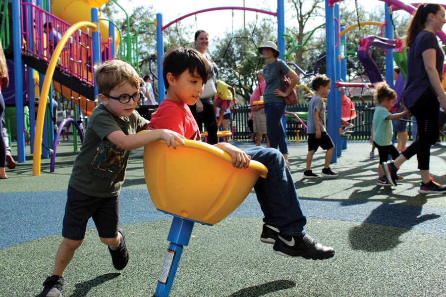 Children of all ages play and enjoy the new Princess Meadow playground, equipped with monkey bars, swirly slides and other amentities, while their families watch over them. Parents and gaurdians were also able to appreiciate the play area as they mingled while their kids played. Photo by Maria Vera