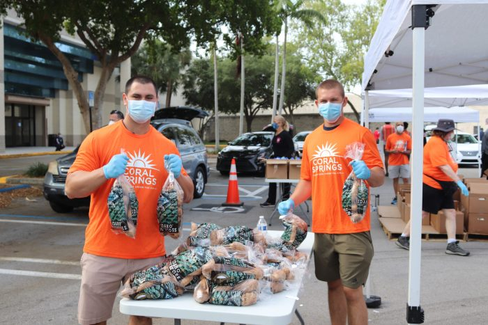 Feeding South Florida volunteers hand out food to community members at Coral Square Mall on April 21. Photo by Fenthon Aristhomene