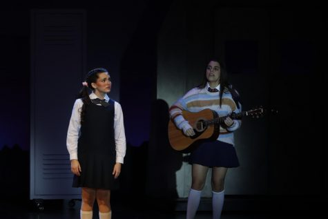 """Harris as female lead Alice in """"Imaginary: A New Musical"""" with senior Andrea Peña on guitar. Photo by Sam Grizelj"""