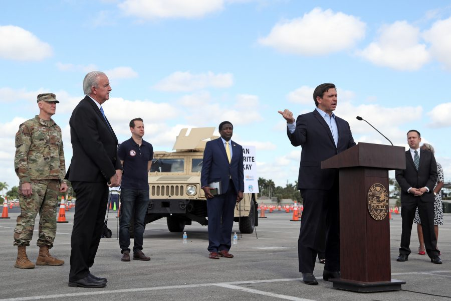 Governor+Ron+DeSantis+speaks+during+a+news+conference+at+the+COVID-19+drive-through+testing+site+at+Hard+Rock+Stadium+in+Miami+Gardens+on+Monday%2C+March+30%2C+2020.+Standing+socially+distanced+are+the+mayors+of+four+South+Florida+Counties%2C+Miami-Dade+County+Mayor+Carlos+Gimenez%2C+Broward+County+Mayor+Dale+Holness%2C+Palm+Beach+County+Mayor+David+Kerner+and+Monroe+County+Mayor+Heather+Carruthers