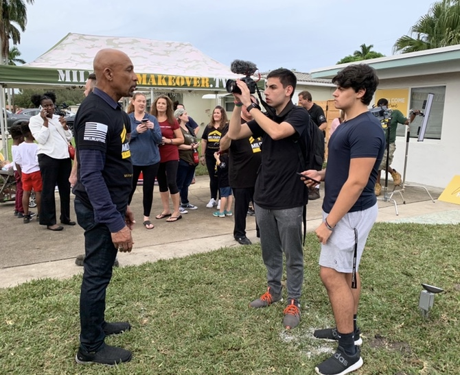 "Riemer interviews Montel Williams on the set of ""Military Makeover,"" a Lifetime show where veteran homes are improved."