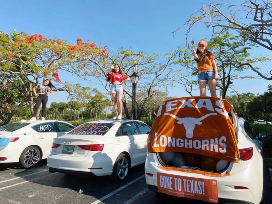 Seniors (right) Leni Steinhardt, (middle) Emily Wolfman, and (left) Sari Kauffman stand on the hoods of their car to follow CDC guidelines while still celebrating decision day. Photo courtesy of Leni Steinhardt
