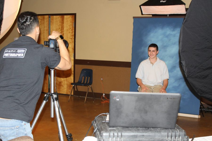 Sloan Henslovitz, freshman, poses for their yearbook photo being taken by (photographer name), Strawbridge photographer
