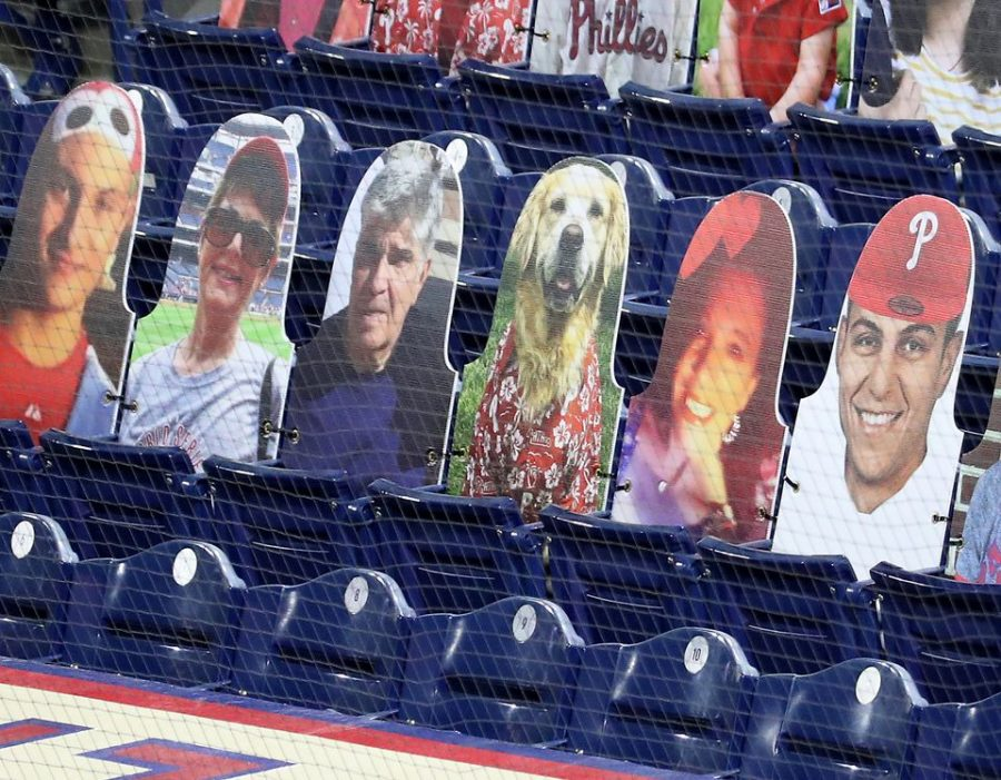 Stadium seats at Citizens Bank Park feature cardboard cutouts of people and a dog.