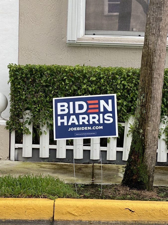 A yard sign showing support for Biden and Harris as the presidential and vice presidential candidate is placed in front of a local's yard.People show their support for Biden by placing signs in front of their yards.