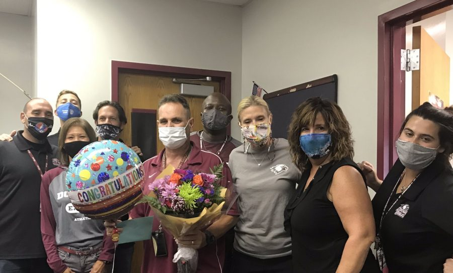 Employee of the Year winner Eduardo Suarez with various members of MSD administration. Photo courtesy of @MSDHighSchool Twitter