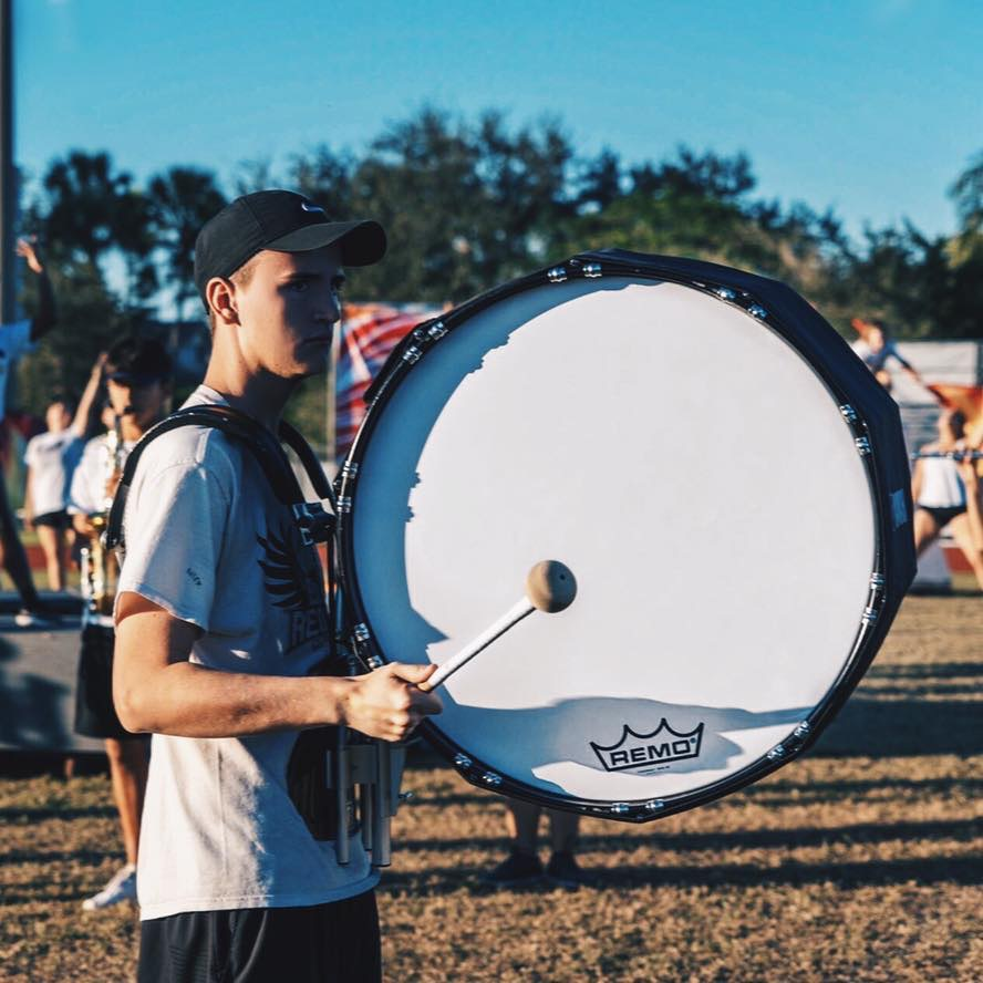 Nicholas Hernandez and set in his drill for the marching band show holding his drum.