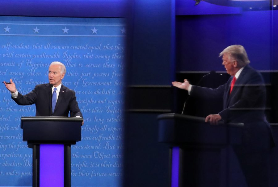 Democratic presidential nominee Joe Biden and U.S. President Donald Trump, shown in a reflection, participate in the final presidential debate at Belmont University on October 22, 2020 in Nashville, Tennessee. This is the last debate between the two candidates before the election on November 3. (Chip Somodevilla/Getty Images/TNS)