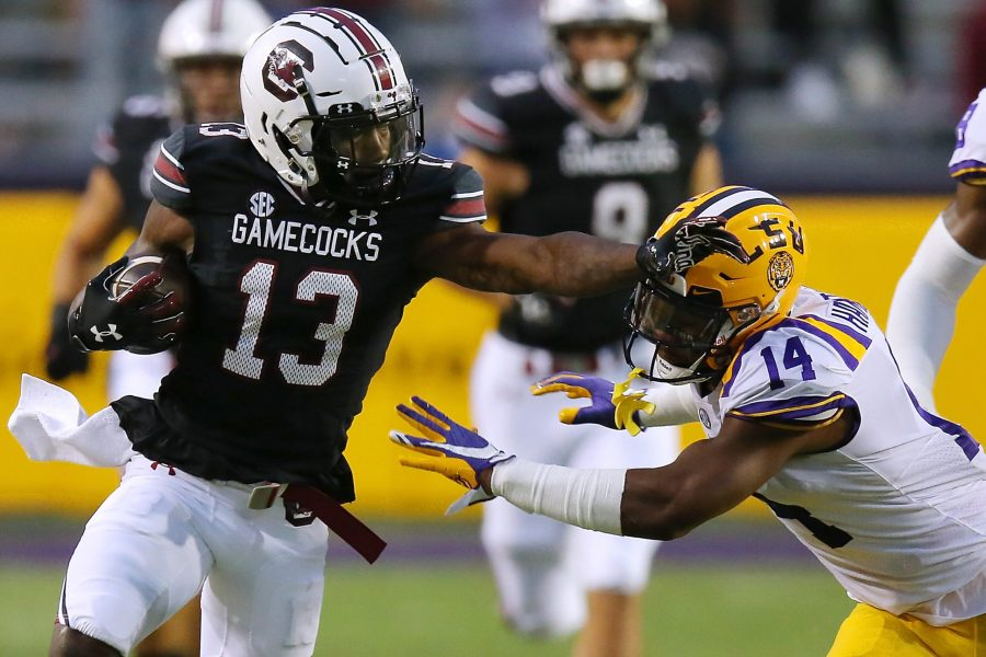 South Carolina's Shi Smith (13) carries the ball as LSU's Maurice Hampton Jr. (14) tries to bring him down at Tiger Stadium in Baton Rouge, Louisiana, on Saturday, Oct. 24, 2020. (Jonathan Bachman/Getty Images/TNS)