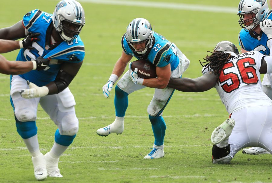 Christian McCaffrey #22 of the Carolina Panthers runs with the ball during the second half against the Tampa Bay Buccaneers at Raymond James Stadium on Sept. 20, 2020 in Tampa, Florida. (Mike Ehrmann/Getty Images/TNS)