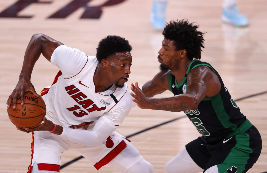 The Miami Heat's Bam Adebayo (13) drives the ball against Marcus Smart of the Boston Celtics during Game 5 of the Eastern Conference Finals at AdventHealth Arena at the ESPN Wide World Of Sports Complex on September 25, 2020, in Lake Buena Vista, Florida. (Mike Ehrmann/Getty Images/TNS)