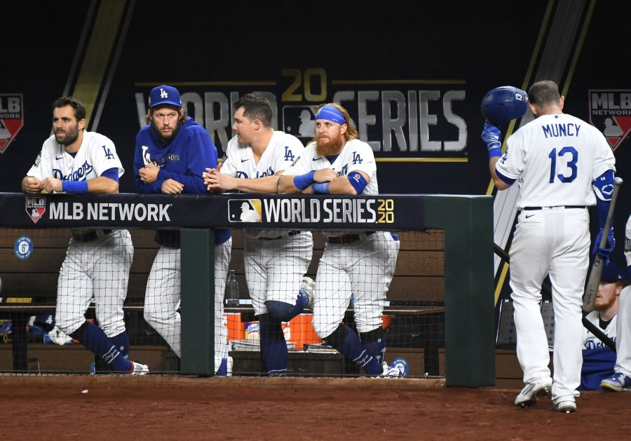The Los Angeles Dodgers' Max Muncy (13) walks back to the dugout after striking out against the Tampa Bay Rays in the fourth inning as teammates, from left, Chris Taylor, Clayton Kershaw, Joc Pederson and Justin Turner, look on against the Tampa Bay Rays in Game 2 of the World Series at Globe Life Field in Arlington, Texas, on Wednesday, Oct. 21, 2020. The Rays won, 6-4, to even the series. (Wally Skalij/Los Angeles Times/TNS)