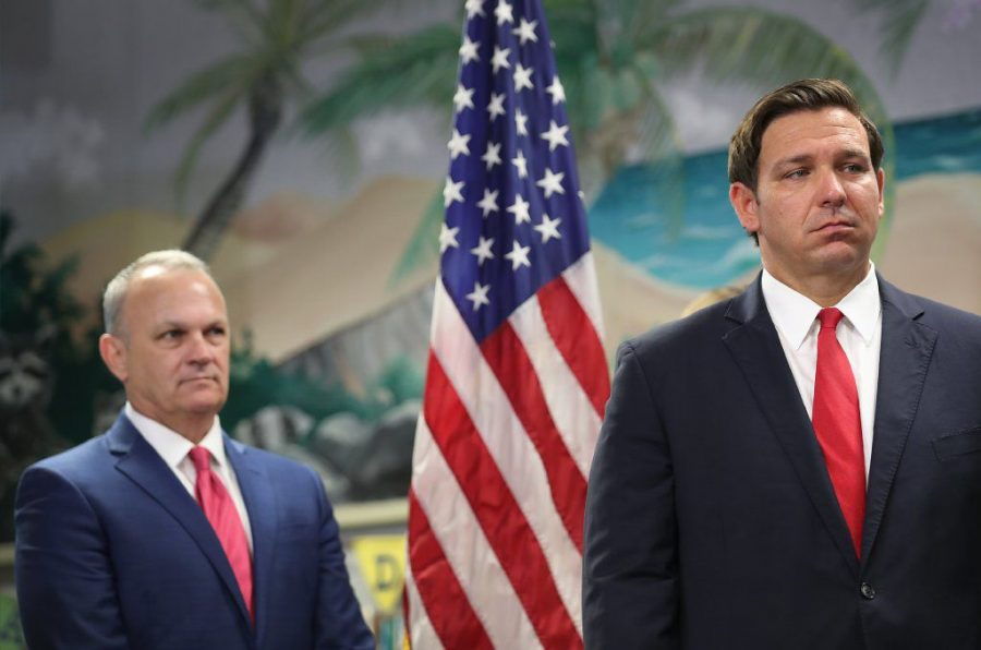 Florida Commissioner of Education Richard Corcoran and Florida Gov. Ron DeSantis (right) and Commissioner Richard Corcoran stand together at a press conference. DeSantis and Corcoran pushed for the full reopening of public schools in August, which prompted a class action lawsuit. Photo courtesy of Getty Images/TNS
