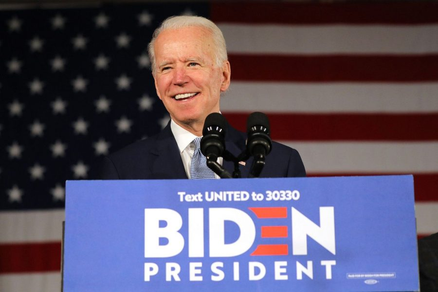 Presidential candidate Joe Biden standing behind a podium with his campaign logo on it.