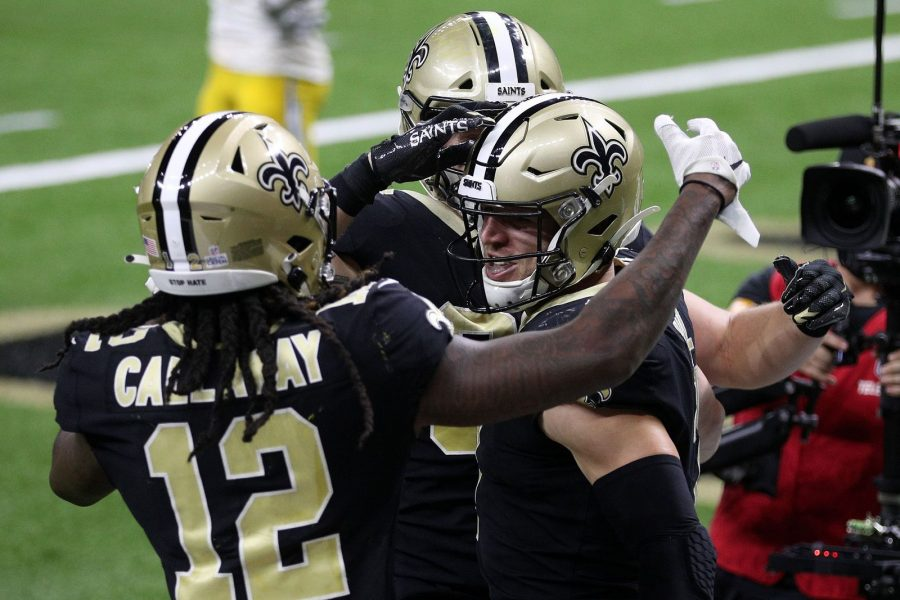 Taysom Hill #7 of the New Orleans Saints celebrates his nine-yard touchdown against the Los Angeles Chargers with Marquez Callaway #12 during their NFL game at Mercedes-Benz Superdome on Oct. 12, 2020 in New Orleans, Louisiana. The Saints won 30-27 in overtime. (Chris Graythen/Getty Images/TNS)