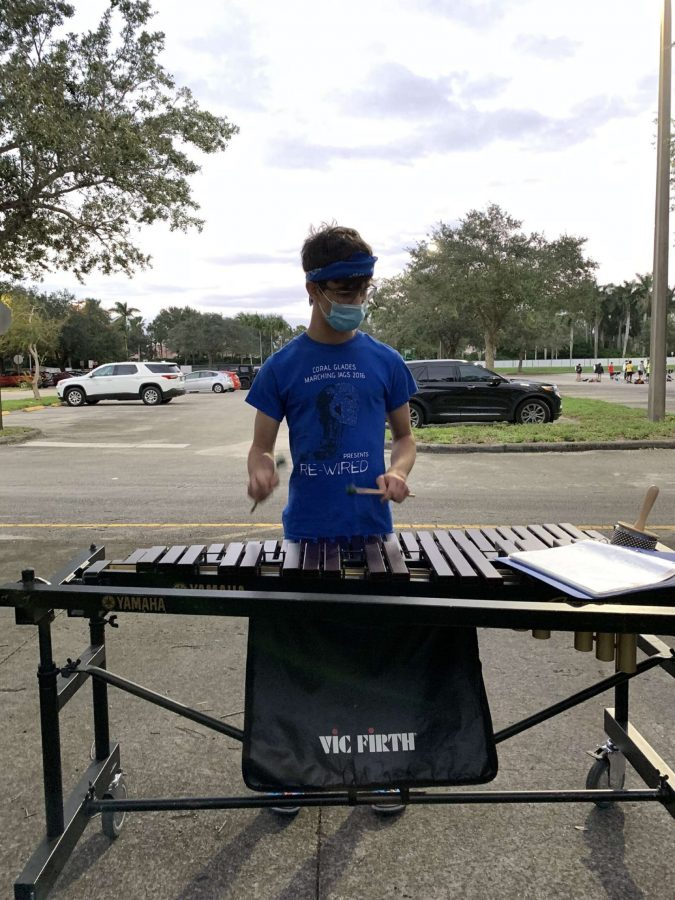 Senior Gabriel Ammirata plays on the marimba for the Eagle Regiment marching band with social distancing guidelines. Photo courtesy of Gabriel Ammirata
