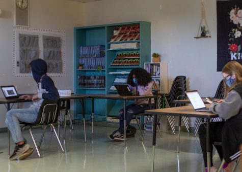 Students in classroom working while socially distant