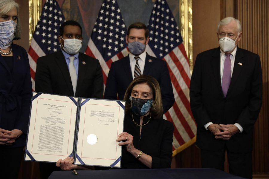 Speaker of the House Nancy Pelosi, D-Calif., signs the article of impeachment against President Donald Trump during an engrossment ceremony on Capitol Hill in Washington, D.C., on Wednesday, Jan. 13, 2021. (Photo courtesy of Yuri Gripas/Abaca Press/TNS)