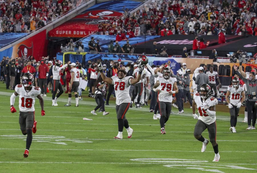 Tampa Bay Buccaneers players celebrate their 31-9 win over the Kansas City Chiefs in Super Bowl 55 Sunday, Feb. 7, 2021 in Tampa.