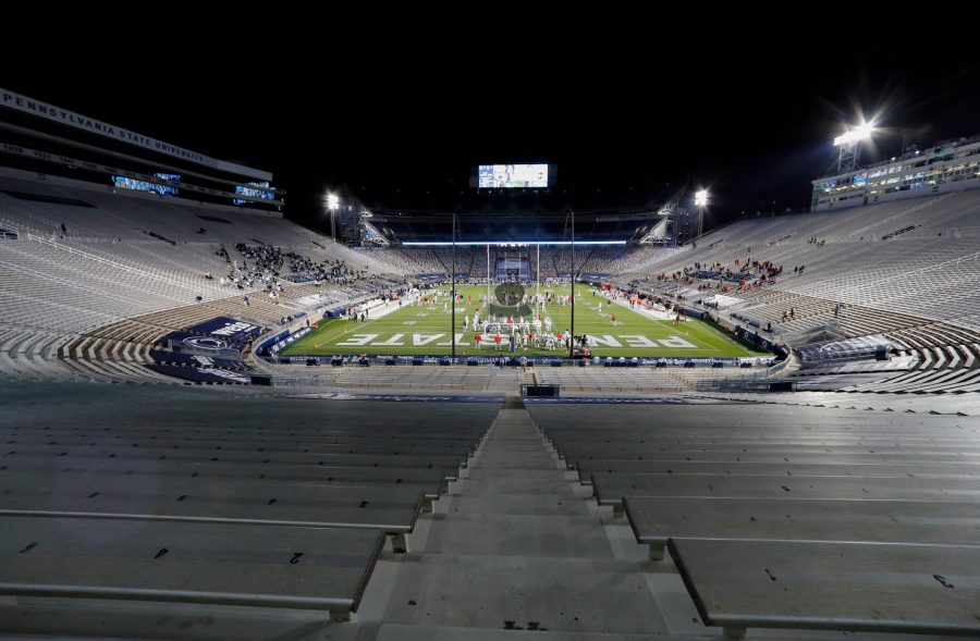 Ohio State players warm up before a game against Penn State in a nearly empty Beaver Stadium in University Park, Pennsylvania, on October 31, 2020. (Adam Cairns/Columbus Dispatch/TNS)