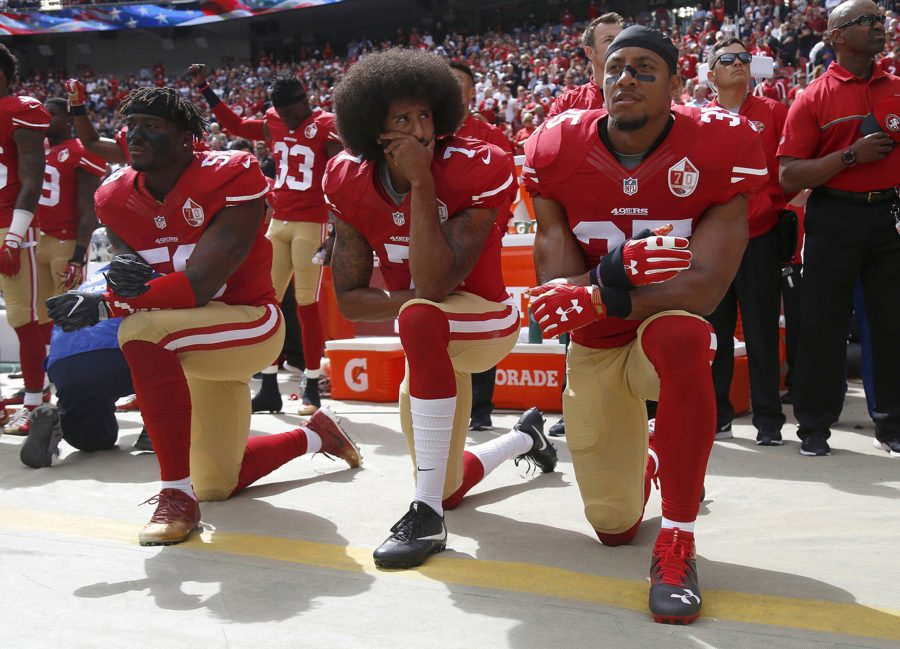 Eli Harold (58), Colin Kaepernick (7) and Eric Reid (35) of the San Franciso 49ers kneel during the national anthem before a game against the Dallas Cowbowy on October 2, 2016, at Levi's Stadium, in Santa Clara, Calif. (Nhat V. Meyer/Bay Area News Group/TNS)