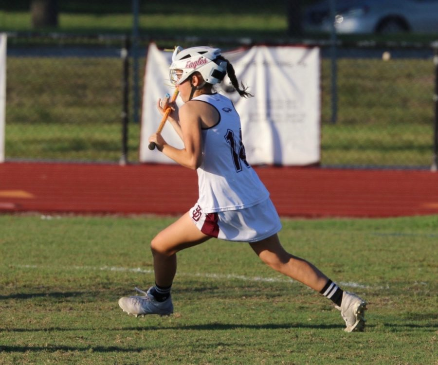 Taking+it+to+cage.+Junior+attackman+Carli+Fleisher+charges+down+the+field+to+score+yet+another+goal.+Photo+by+Jen+Dorfman