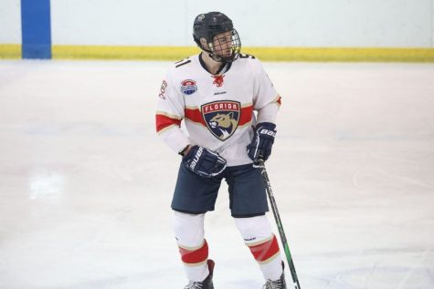 Photo of Adam Hauptman on the ice playing hockey for his previous travel hockey team, the Junior Panthers. Photo provided by Adam Hauptman