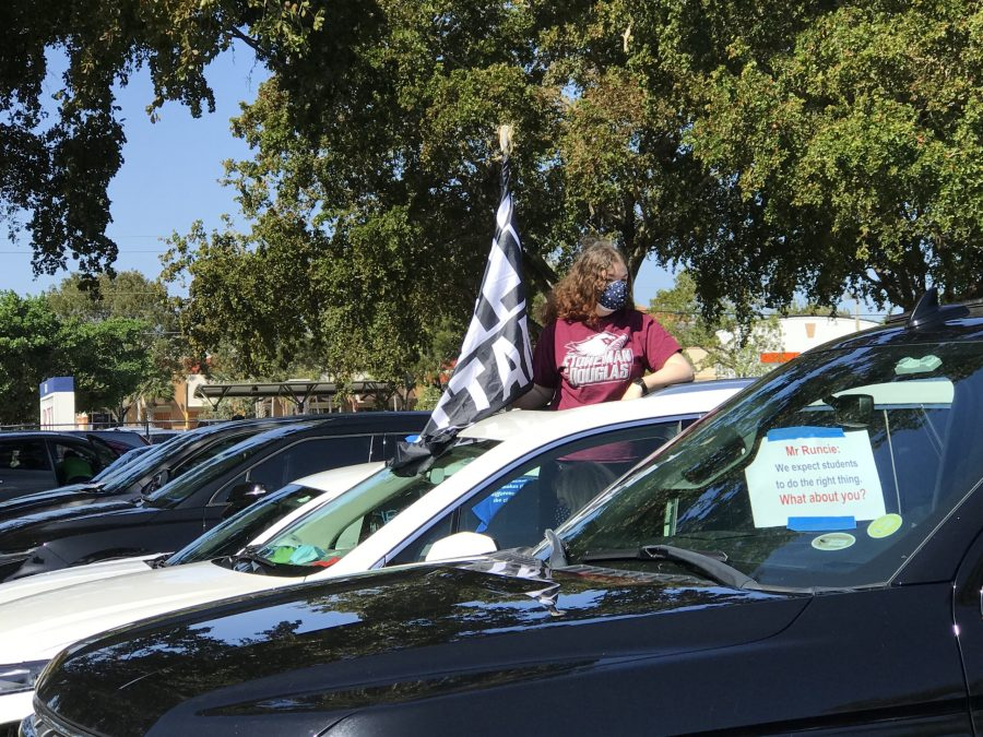 Junior Hailey Jacobsen joins hundreds of Broward Teachers Union members for a car caravan rally in protest of medically compromised teachers being forced back to campus by Broward County Public Schools and the Florida Department of Education. Over 200 cars participated in the event on Saturday, Feb. 20 at 10 a.m. Photo courtesy of Melissa Falkowski