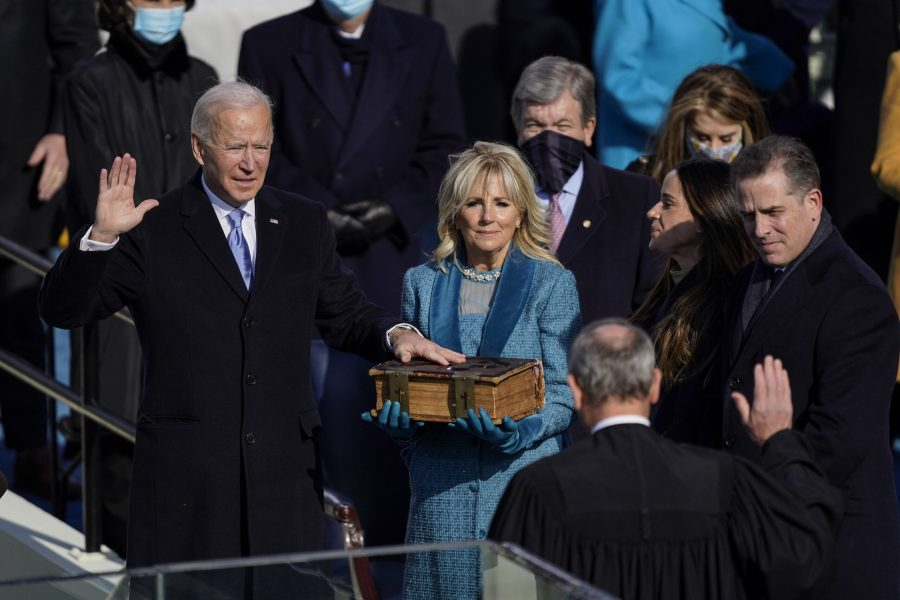 President Joe Biden takes the oath of office from Supreme Court Chief Justice John Roberts as his wife, first lady Jill Biden, stands next to him during the 59th presidential inauguration. Photo courtesy of Kent Nishimura/Los Angeles Times/TNS