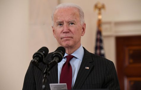 President Joe Biden speaks about lives lost to COVID-19 after the death toll passed 500,000, in the Cross Hall of the White House in Washington, D.C., on Monday, Feb. 22, 2021. (Saul Loeb/AFP/Getty Images/TNS)
