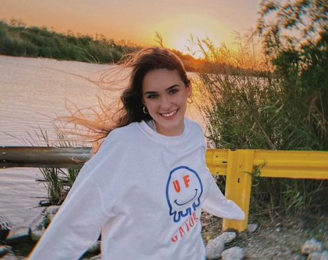 Lexie Sealy stands in front of river in University of Florida gear.