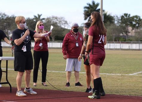Inspiring the Team to Success. Coach Laura Rountree celebrates senior defender Jordan Carrey (24) on the Eagles senior night. Rountree prepared words for Carrey and the other 4 seniors on Girl