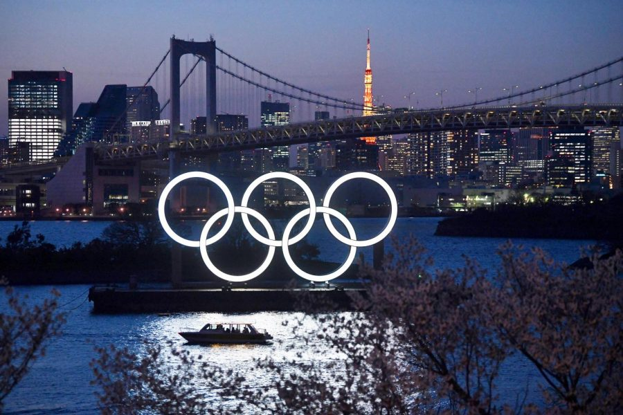 A boat sails past the Tokyo 2020 Olympic Rings on March 25, 2020, in Tokyo. The 2020 Olympics were postponed to 2021 because of the ongoing COVID-19 pandemic. Photo courtesy of Carl Court/Getty Images/TNS