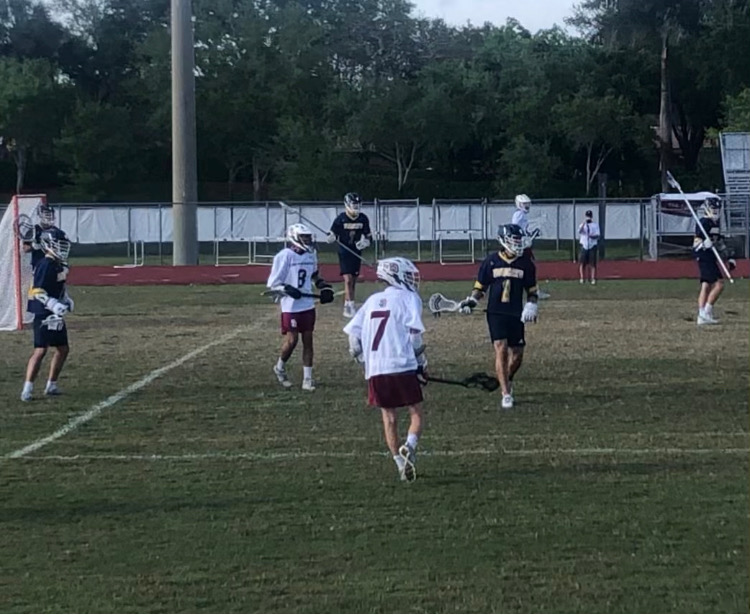 Pressing the Issue. Eagles attacker Preston Gerena (7) looks for a pass in the second half. The Eagles scored late, but fell 11-7 against a strong Boca Raton team.