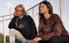 Mali Apparel co-founders Maria Anzurez and Mariana Jimenez modeling their custom sweaters. Photo courtesy of Mali Apparel