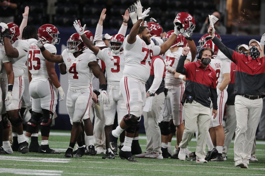 Alabama+players+and+Nick+Saban+react+after+running+back+Najee+Harris+scored+a+touchdown+to+take+a+42-31+lead+over+Florida+during+the+fourth+quarter+in+the+SEC+Championship+on+Saturday%2C+Dec.+19%2C+2020%2C+in+Atlanta%2C+Georgia.+Photo+courtesy+of+Curtis+Compton%2FAtlanta+Journal-Constitution%2FTNS