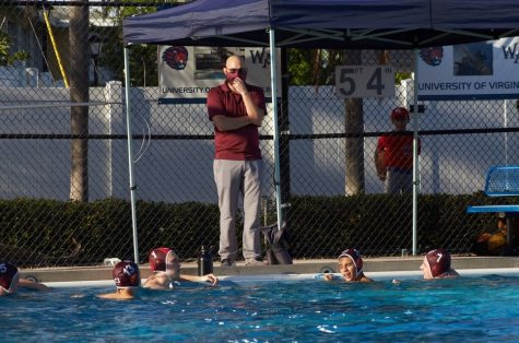 Coaching. Water polo coach Jacob Abraham talks to his team on the side of the pool during a game against West Minster Academy. Photo Maria Jose Vera.