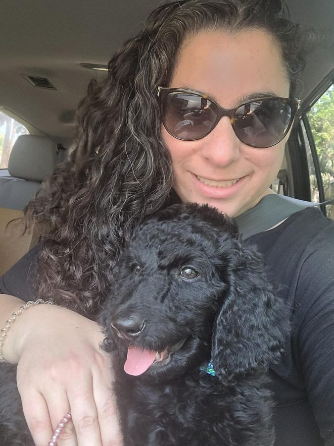Lieberman sits in her car with her new dog Romeo. Photo courtesy of Jacqueline Lieberman