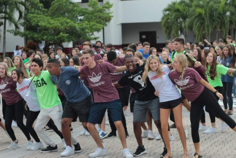 Students stand with eachother in the courtyard before the COVID-19 pandemic. Photo by Brianna Jesionowski