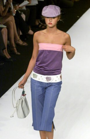 A model wearing a silk top and pant by designer Marc Jacobs walks the runway during the Spring 2001 Men