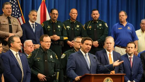 Gov. Ron DeSantis holds a press conference at the Polk County Sheriffs Office, on Monday, April 19, 2021. The governor signed into law a new riot bill, surrounded by law enforcement, legislators and police union representatives. Photo courtesy of Ricardo Ramirez Buxeda/ Orlando Sentinel/TNS