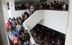 Students pack the stairwell in front of the media center and cafeteria as they make their way to class. Marjory Stoneman Douglas High School has at least 3,650 students enrolled for the 2020-2021 school year.