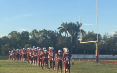 The MSD varsity football team lines up to stretch between the halves of the Kickoff Classic against the American Heritage Stallions. Photo by Reece Gary