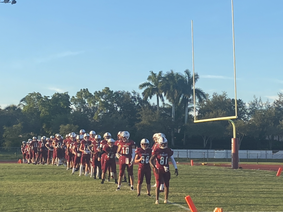 The+MSD+varsity+football+team+lines+up+to+stretch+between+the+halves+of+the+Kickoff+Classic+against+the+American+Heritage+Stallions.+Photo+by+Reece+Gary