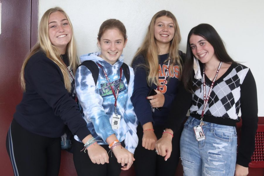 Sophomores Gracyn Haynes, Lily Shortz, Stephanie Bilsky, and Emma Kramer show off their handmade bracelets they created together for their ocean conservation business. The girls decided to form a business that makes and sells bracelets in order to help protect and preserve the oceans environment.