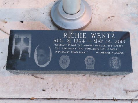 A plaque honoring the late Richard Wentz rests at the base of the flagpole in front of Marjory Stoneman Douglas High School. His dedication and sacrifice being a member of the New York Police Department is worth remembering as he rescued victims of the terrorist attacks on Sep. 11, 2001.