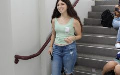 Sophomore Dana Bercun poses in her mom jeans during lunch. Along with many other teenage girls, she styles her mom jeans with a pair of Nike Air forces and a colorful tank top.