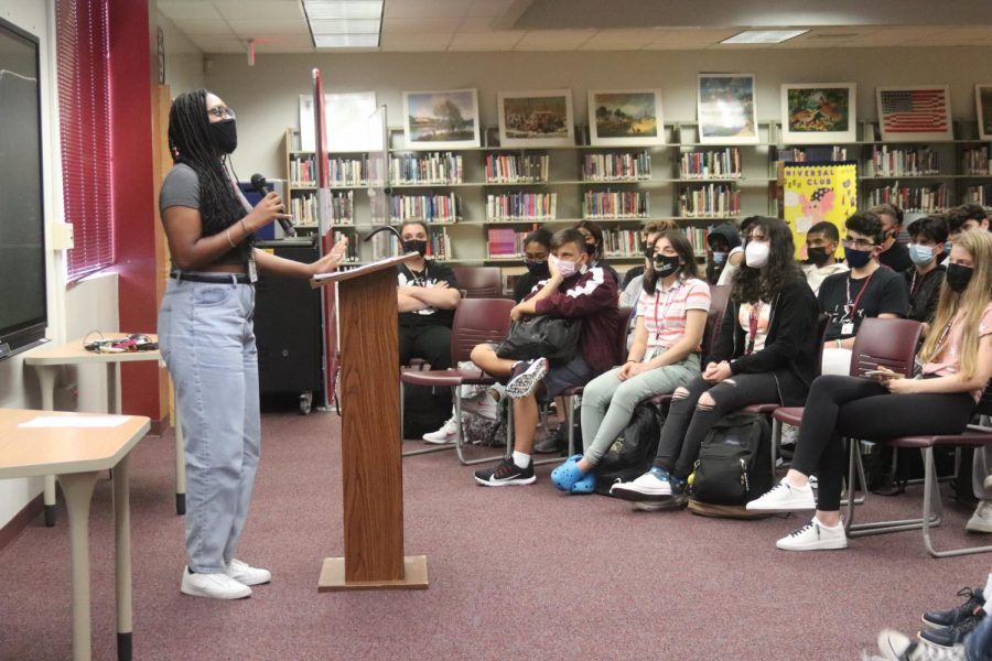 """Tapping into character, junior Noldine Belizaire emotionally acts out a monologue in the media center from the book """"With Their Eyes"""" on Friday, Sep. 10, as a part of the Drama Club"""