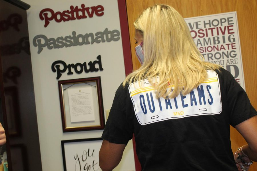 Keffords shirt features the words OUTATEAMS on the back, relaying the joy to be back on campus instead of Microsoft Teams, a spin on the OUTATIME license plate from Back to the Future.